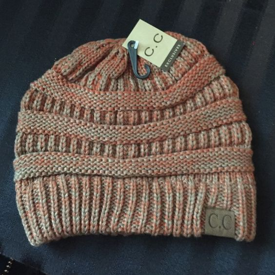 C.C Beanie Super cozy multi color beanie!  Has orange, taupe and a little light blue.  Would pair perfect with jeans! Accessories Hats