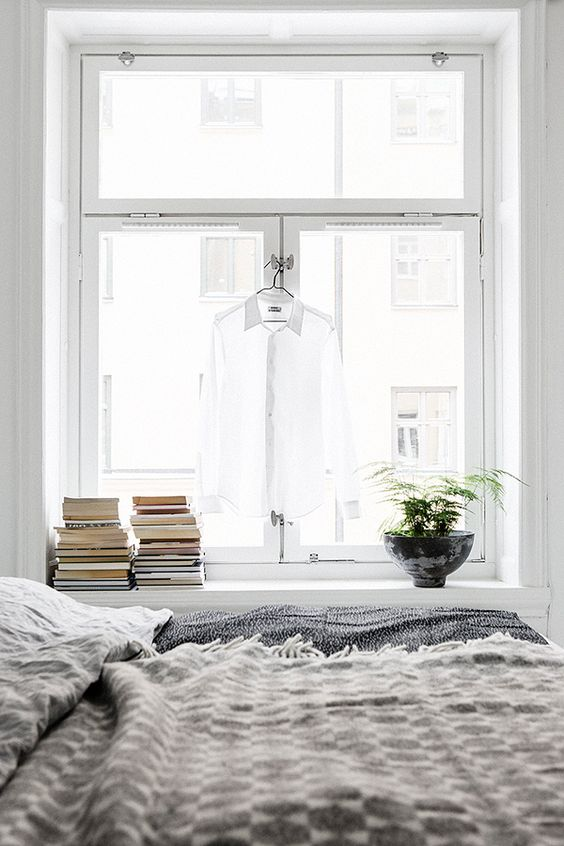 Bedroom with natural light. Preparation space for tomorrow's outfit = windowsill.:
