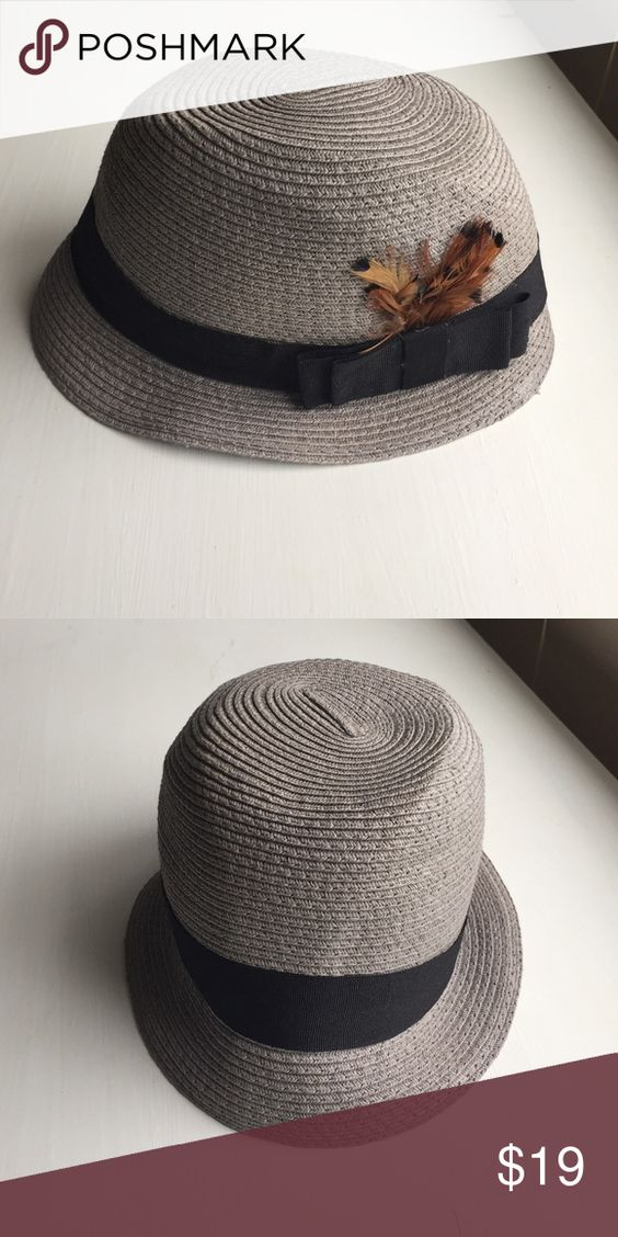 Urban Outfitters grey feather cloche hat Urban Outfitters grey straw hat w/black ribbon & brown feather cloche style hat - soft form not stiff - Kimchi Blue - perfect condition was never worn! Urban Outfitters Accessories Hats