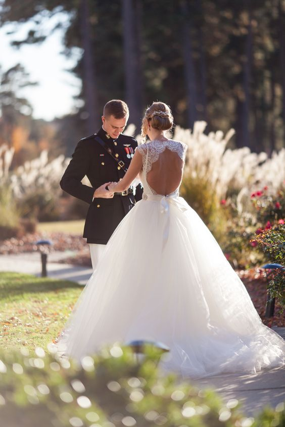 Military Groom & Bride in Ball Gown with Keyhole Back | Photography: Renee Sprink Photography. Read More: http://www.insideweddings.com/weddings/a-blue-white-gold-military-wedding-at-duke-university-chapel/622/