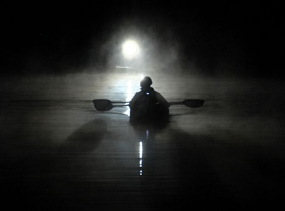Paddling in the fog  By Tim Curtis