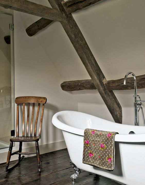 Country Bathroom with Polished Floorboards and Freestanding Bath: