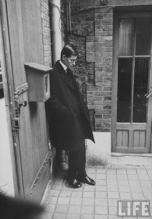 Yves St Laurent photographed after the funeral of Christian Dior, October 1957.