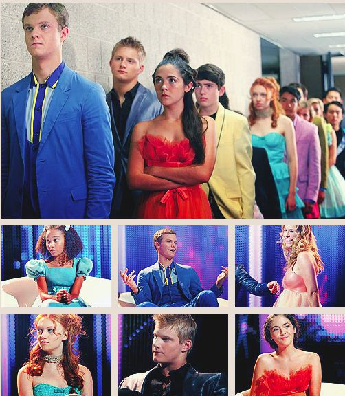 Rue, Marvel, Glimmer, Foxface, Cato, Clove and Katniss and Peeta way in the back waiting to be interviewed.