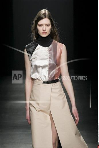 (AP)- Model wears a creation by Ter et Bantine fashion house, as part of the women's ready-to-wear winter 2015/2016 Milano women fashion week, Milano, Italy/ March 02, 2015 (Sipa via AP Images)
