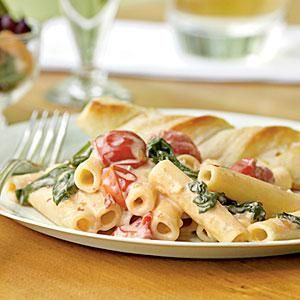 Ziti with Spinach, Cherry Tomatoes, and Gorgonzola Sauce - Gorgonzola, an Italian blue cheese, gives this grown-up mac and cheese dish pungent flavor. If youd like to make it more family-friendly, substitute your favorite blue or other creamy cheese. You can also substitute penne or rigatoni for ziti. Total time: 40 minutes..  Print this recipe at AmericanFamily.com.