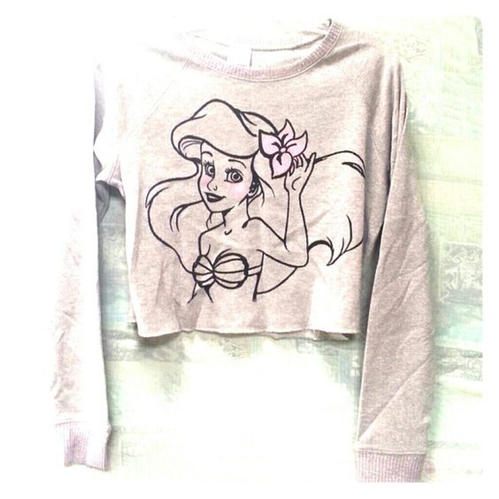 Ariel sweater Ariel crop top sweater. Size large. The color is cream with pink sparkles throughout the fabric as can be seen in the last photo. disney Sweaters