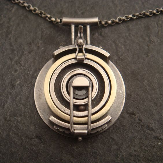 This looks like something straight out of Myst! Wedding Band Holding Pendant by DownToTheWireDesigns