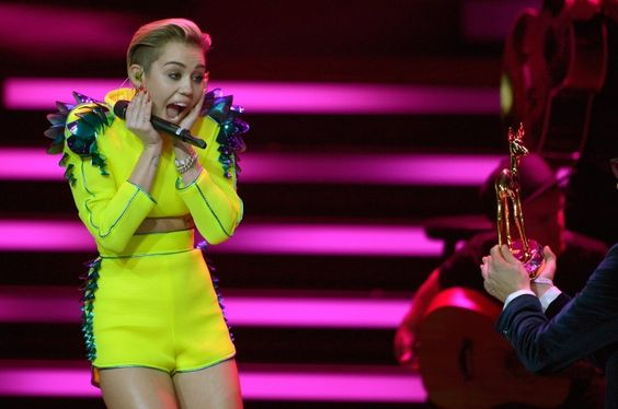 Frequent shocker Miley Cyrus manages to receive a surprise of her own while accepting the International Pop award at the Bambi 2013 awards on Nov. 14 in Berlin