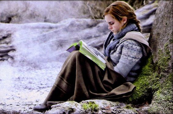 My favorite things all wrapped into one: Hermione Granger, snow, forests, books, blankets, sweaters, scarves, and warm drinks.
