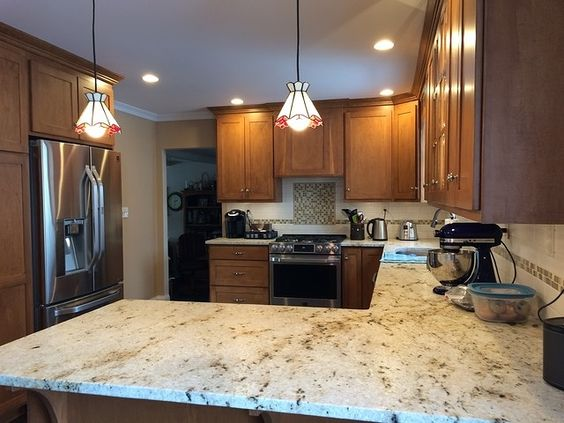 Medium brown cabinets really pull out the gold in the colonial gold granite. With squared off corners here, you're getting a very standard style kitchen but still a nice looking one.