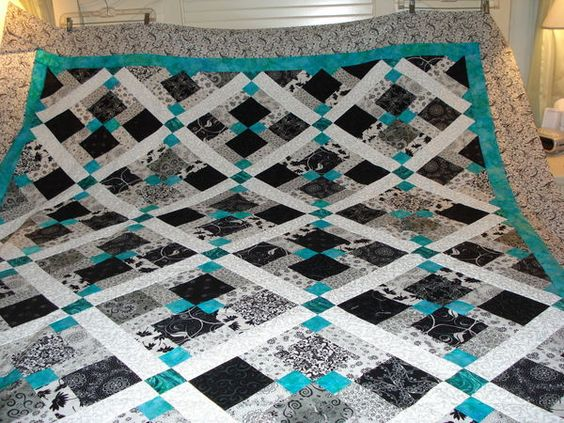 Disappearing 9 patch - great variation. super cool looking but probably too difficult for first quilt!