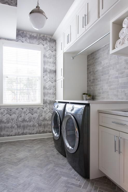 Gray Laundry Room Featuring Gray Herringbone Pattern Floor Tiles