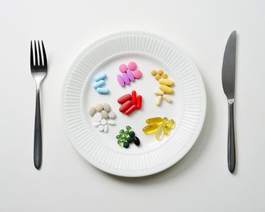 pills on a plate - David Malan/Photographers Choice/Getty Images: