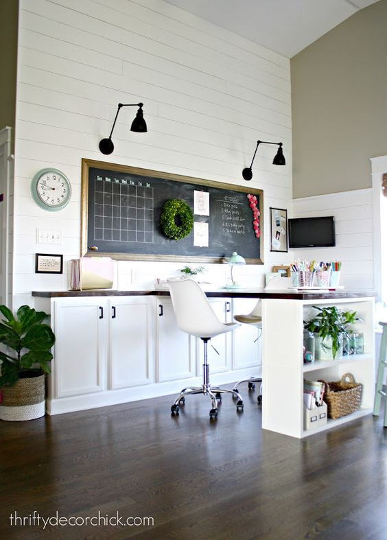 With a beautiful, large desk space, plenty of storage, and stylish shiplap walls, a creative space as charming as this doesn't come around often. Makeover your craft room with a similar, neutral aesthetic and enjoy your freshly designed area!