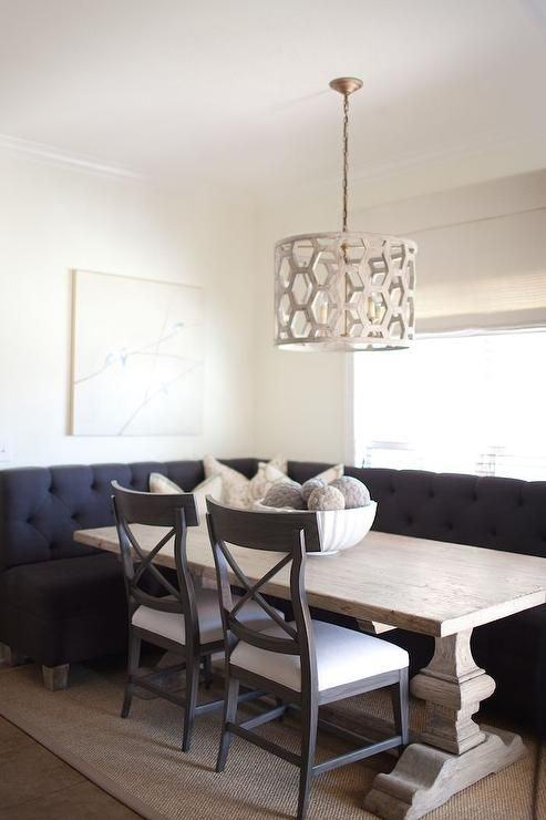 Chic Breakfast Nook Features A L Shaped Black Tufted Banquette Facing Reclaimed Wood Trestle