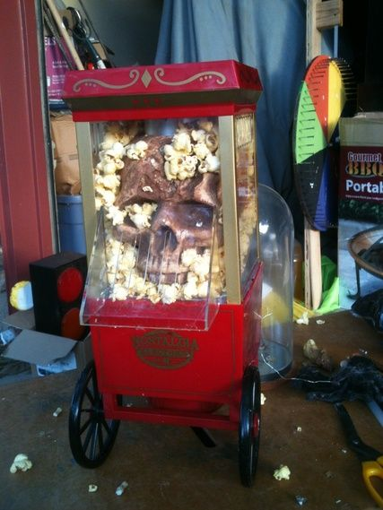Well, I got a few more things done last night. Not completely happy with the popcorn machines......maybe i need to add some blood????? And I got my madagascar hissing roach display for the oddities, took me a whole 5 minutes to do that one, I was tired...any suggestions on upping the creep factor?