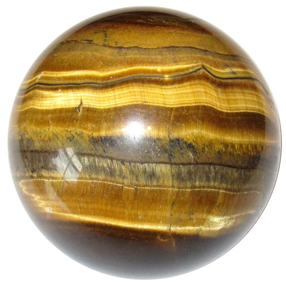 Your crystal ball is made from an attractive Tigers Eye. This treasure has silky chatoyancy, with golden brown ribbons and various patterns on the chocolate brown mineral. Your sphere has a polished surface, yet retains natural lines and inclusions. Measures: 1.9 inches. Weighs 5.6 ounces. Tiger's Eye is protective, watching over your space and family. It holds the energy of the feline, bringing confidence, self-esteem, and courage. Tiger's Eye is associated with the second chakra. Receive this