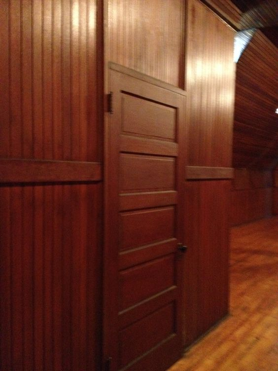 A door in the Attic. The stage is straight ahead to the right. | James J. Hill House