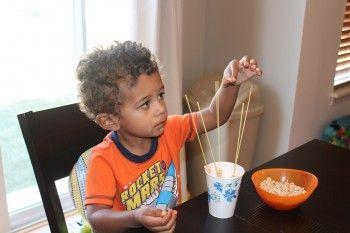 cereal on spaghetti- great fine motor skill practice