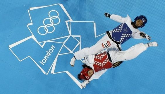 Thailand's Chanatip Sonkham fights Guatemala's Elizabeth Zamora Gordillo (in red) during their bronze medal match in women's 49-kg taekwondo competition at the 2012 Summer Olympics, Wednesday, Aug. 8, 2012, in London. (AP Photo/Charlie Neibergall)