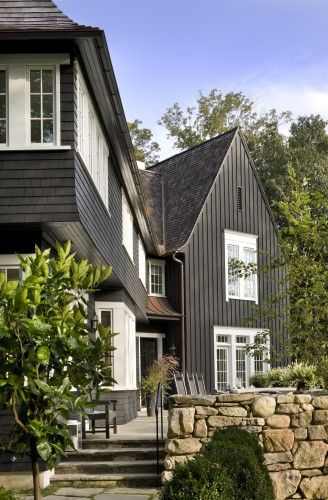 Exterior colors.  By Ike Kligerman Barkley   Love the steep roof and dark vertical siding w/ white accents, stone retaining wall