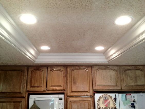 Remove fluorescent lights, replace with can lights and crown moulding