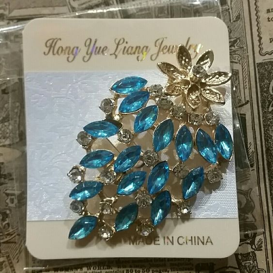 Cute Blue Rhinestone Pin Brooch NWT Super cute brooch new in package. Great for Christmas gifts/stocking stuffers! Jewelry Brooches