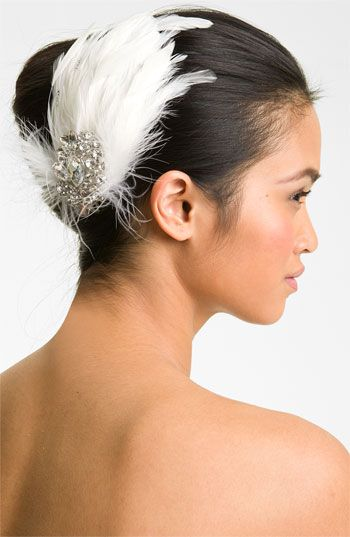 Tasha 'Havana' Salon Clip  A brooch of sparkling crystal gems provides a striking centerpiece to a feathery hair clip with vintage glamour.          Feather/crystal/metal.