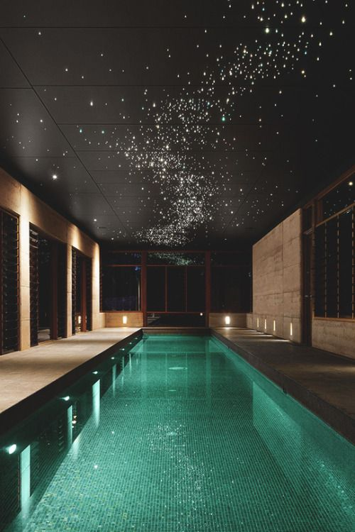 I would love an indoor pool like this... the sparkle of the star-like lights…