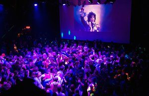 Minnesota, US Guests dance to Prince music as a slide show flashes images of the…