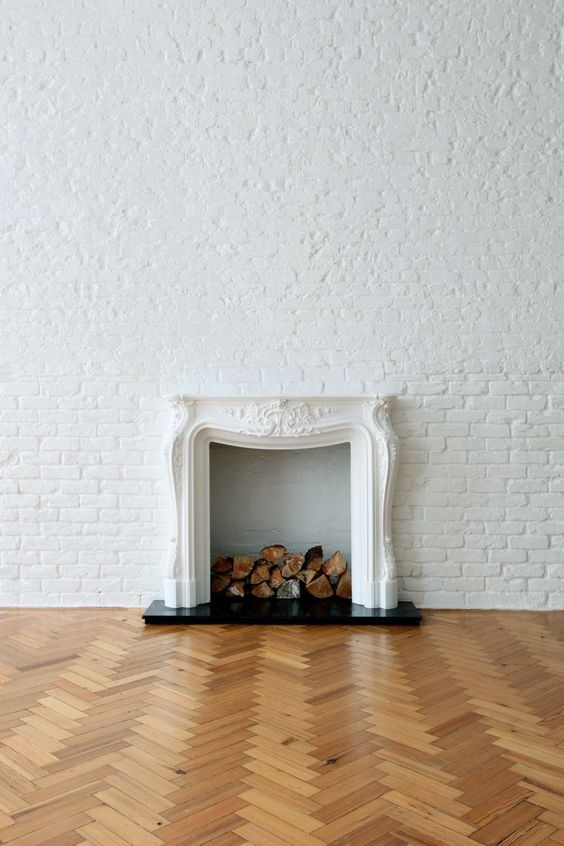Creating space ready to go: fireplace , wood floors and brick wall.