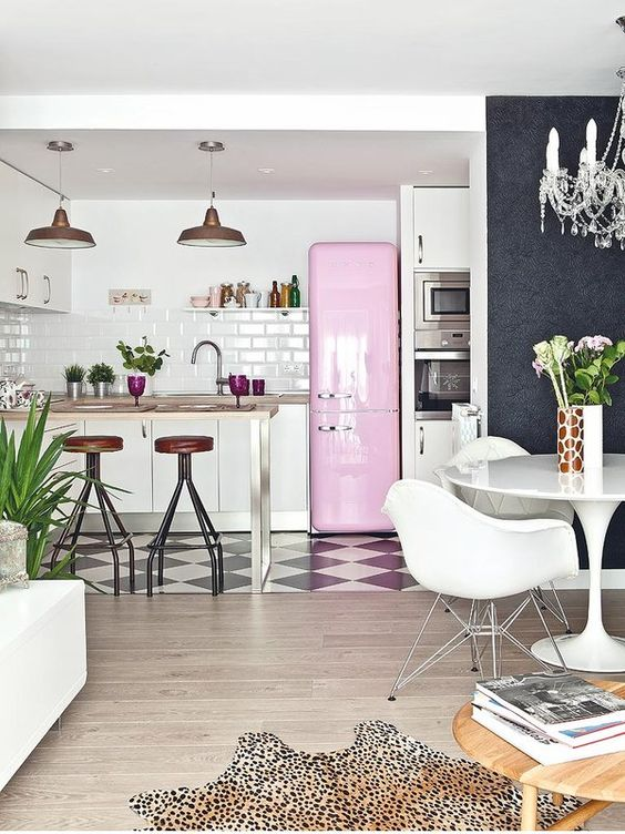 White kitchen and dining area with pops of colour:
