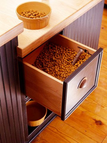 Pet food storage and underneath a place for pets to eat.