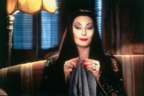 Morticia Addams - one badass mama. Family first, always.