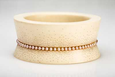 Ashley Warsaw: hand carved wooden bracelet with a gold wire inlay. 14k rose gold, pearls, 2009