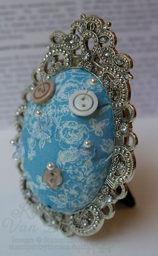 pin cushion in a small fancy frame - like this idea for special earrings on my dressing table.