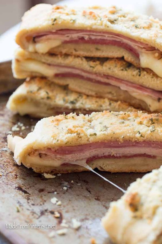 This recipe is so beloved in our family because it is easy to make and tastes just as good next day hot or cold. My son used to love Stromboli for his school lunches. The key to this Stromboli is the order you lay the meats. We always do ham, turkey, cheese, then salami. When it cooks up the ham and salami flavor the bread and taste amazing. The crunchy parmesan topping tastes as good as it looks, I promise!