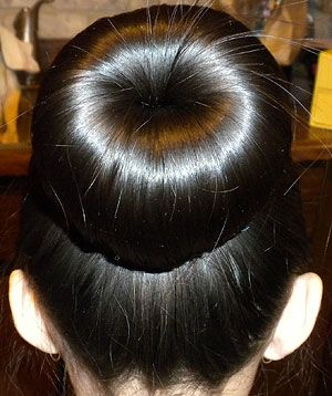 Now here's a quick and easy 'do: The Sock Bun. This bun goes with any style you are rockin' for the day, and looks perfect for so little effort! For a tutorial for this magnificent bun and for Sock Bun CURLS (how great does that sound!), visit: http://lefoof.blogspot.com/2011/11/sock-bun.html Hope your results are great!