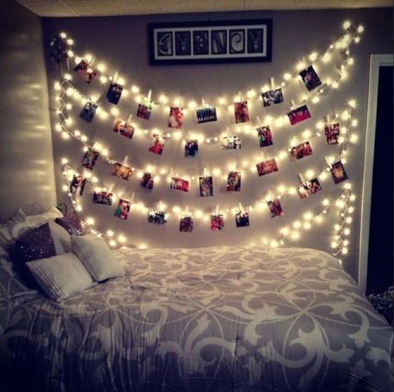 Instead of using twine or wire to clip up pictures, how about twinkle lights? :)