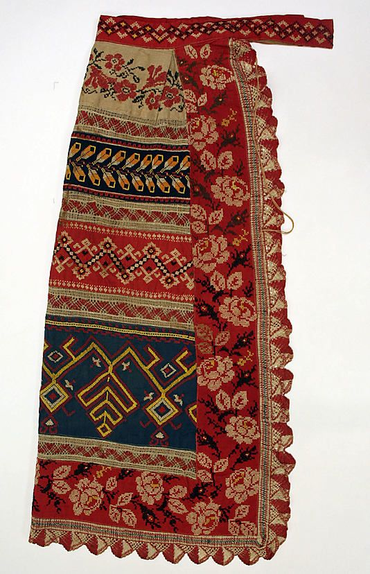 Russian apron - I have always loved mixing up patterns together - the combination of roses on a red background and the other woven patterns is sublime: