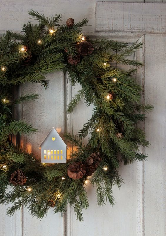 Beautiful Christmas Wreath with Lights, Pinecones and Greenery - 13 Dashing Christmas Door Decorations to Impress Your Neighborhood