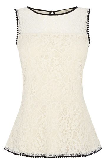 This pretty peplum top features a textured lace floral effect across the fabric and is finished with a black piping trim.