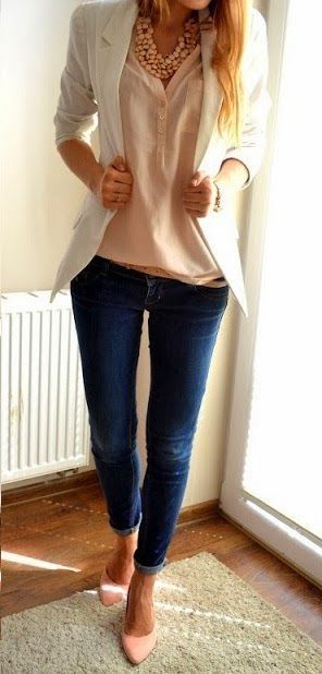 White blazer looks ladylike and versatile worn with semi-sheer cream white blouse tucked in dark blue slim-fit jeans.: