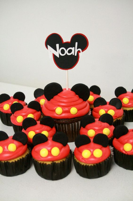 For Raine's bday. Could use mini oreos or peppermint patties as ears. Would do chocolate icing with crushed oreos on top, and red liners with yellow dots. Maybe crushed oreos in cake batter.