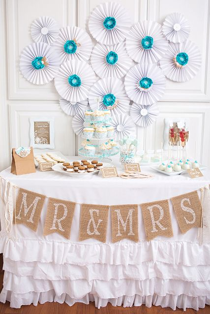 A burlap banner paired with an adorable ruffle tablecloth will create a rustic chic party look.: