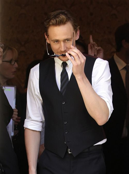 Such a good look on him, the waistcoat and the rolled up shirtsleeves!