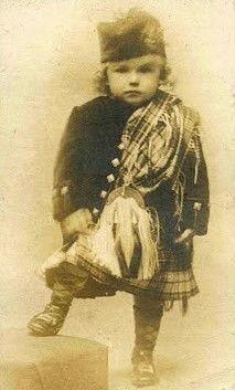 Little boy wearing Scottish Highland kilt: