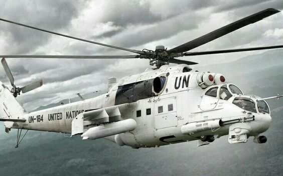 This is the Mil Mi-24P Hind-F with a 30mm GSh-30K twin-barrel cannon mounted on the right side of the helo in UN colors.  The United Nations supposedly use 5 Hinds in their operations around the World.