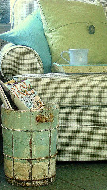Old bucket as magazine holder. Beautiful patina.